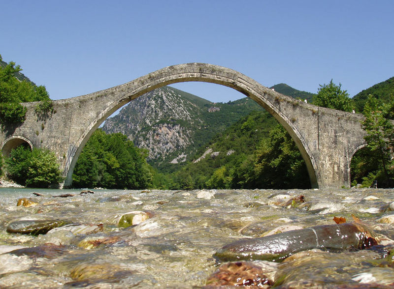 Historic Plaka single-arch stone bridge in Greek Region of Epirus restored