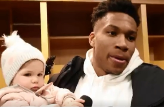 Giannis Antetokounmpo holds baby during entire TV interview (video)