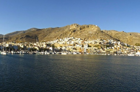 Kalymnos islanders paint giant Greek flag on top of the hill