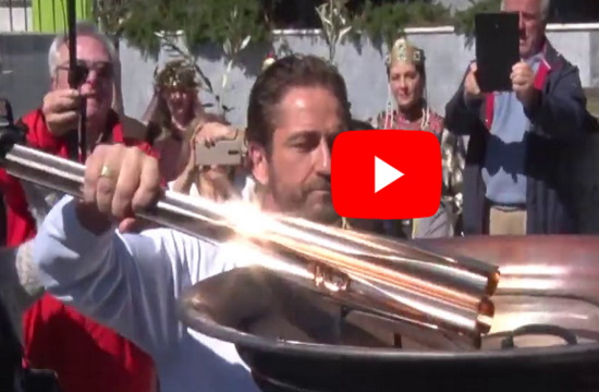"""Olympic torchbearer Gerard Butler shouts """"This is Sparta"""" as he lights altar"""
