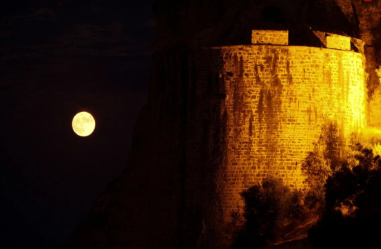 Full moon shining bright over Koroni castle in southern Greece