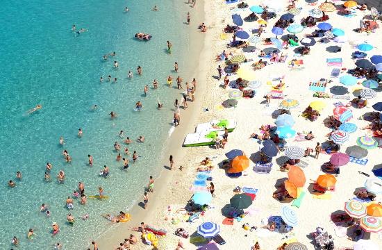 AP: Europeans soak up the sun but Coronavirus travel rules a puzzle