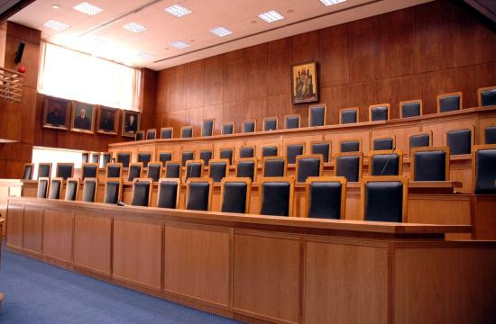 Journalist files lawsuit against self-proclaimed billionaire in Greece