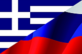 Greek and Russian Foreign Ministers shake hands on renewing relations