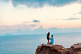 Teenager looks for couple after capturing their proposal on camera in Santorini
