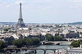 AP: Eiffel Tower reopens in Paris ending 104-day Covid-19 shutdown