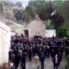 Clip of priest's funeral in Crete with gunshots goes viral (video)