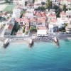 Report: The Greek town where each house boasts a private beach (video)
