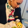 Photo of flight attendant breastfeeding passenger's baby goes viral