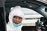 Naomi Campbell wears full-body white protective suit at airport